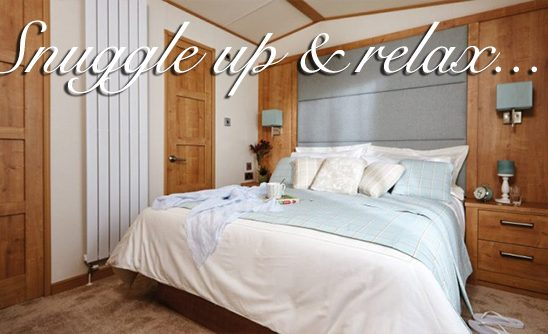 A double bedroom in a luxury lodge at Silverdyke Park