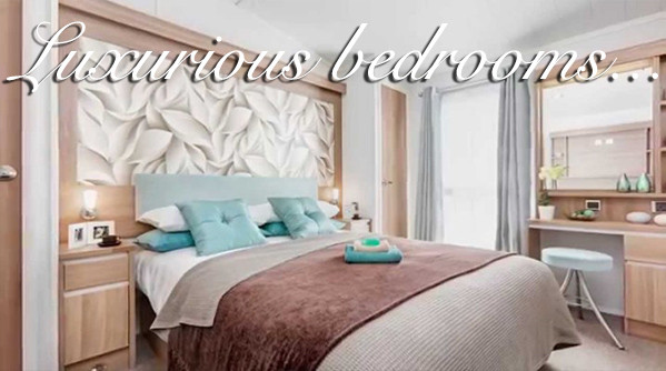 A bedroom in a holiday home at Silverdyke Park saying luxurious bedrooms