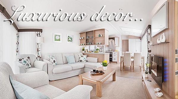 A living area in a holiday home at Silverdyke Park with text saying luxurious decor