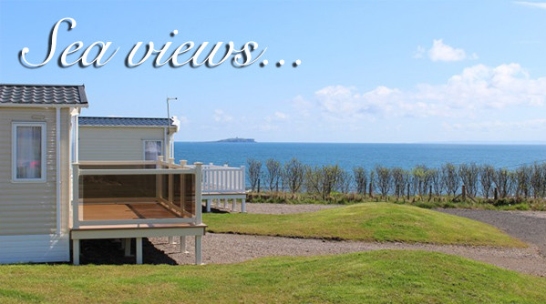 Holiday homes at Silverdyke Park with a view of the sea and text saying sea views