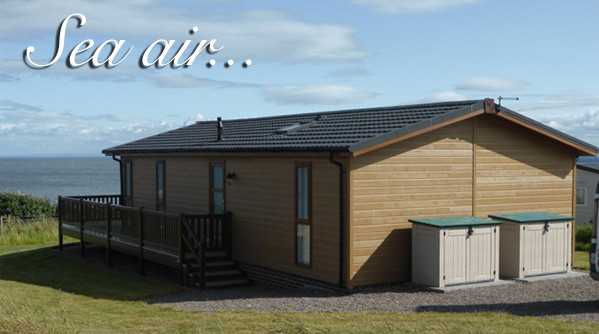 A luxury lodge over looking the sea at Silverdyke Park with text saying sea air