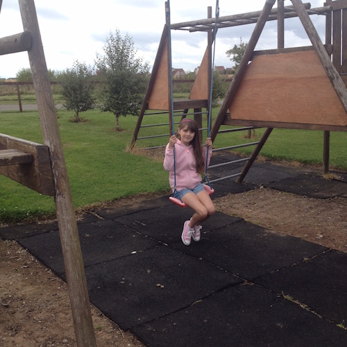 A child on a swing at Silverdyke Park