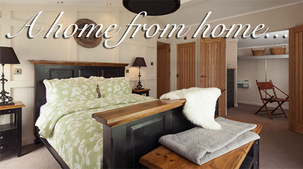 Luxury double bedroom at Silverdyke Park with text saying a home from home