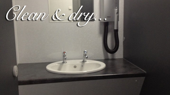 Sink and hair dryer at Silverdyke Park with text saying clean and dry