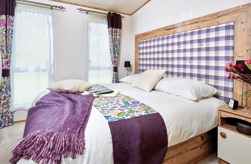 Luxurious bedroom in a holiday home for sale at Silverdyke Park