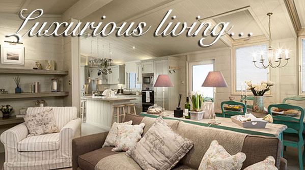 A luxury living area at Silverdyke Park in a luxury lodge with text saying luxurious living