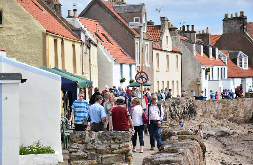 Pittenweem Arts Festival with people walking the streets of Pittenweem