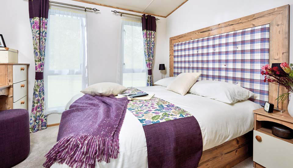 A luxury bedroom in a holiday home at Silverdyke Park